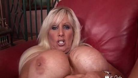 Cougar With Huge Phony Knockers Swallows A Big Load -  Tia Gunn